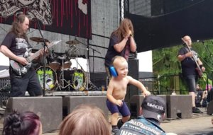 Watch a toddler storm the stage at an extreme metal festival